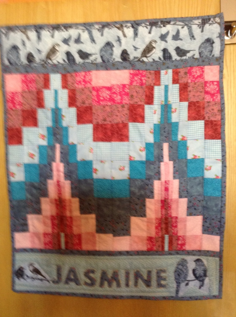 Front of the quilt with baby's name
